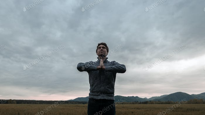 Young man meditating in nature