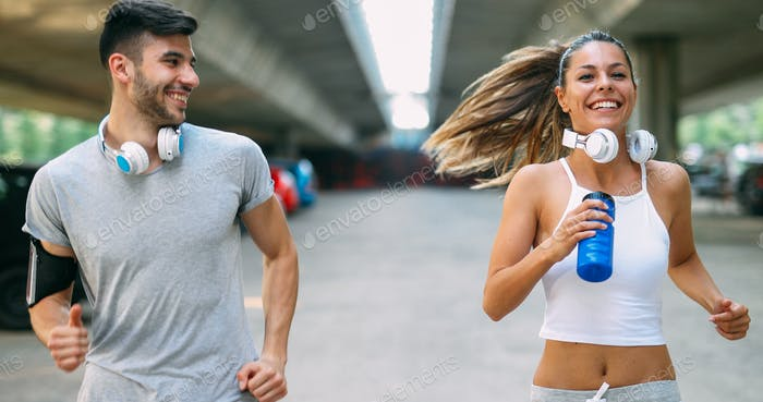 Attractive man and beautiful woman jogging together