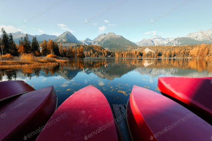 Red boats on Strbske Pleso lake