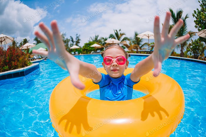 Little smile girl in outdoor swimming pool