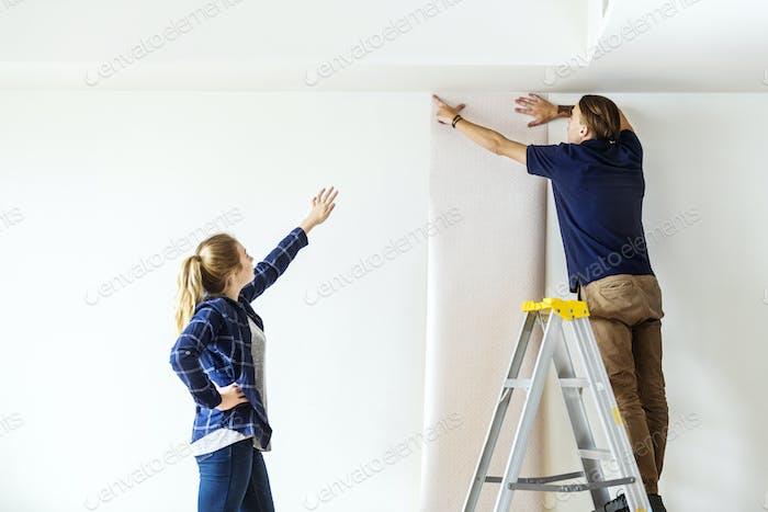 Couple choosing house wallpaper