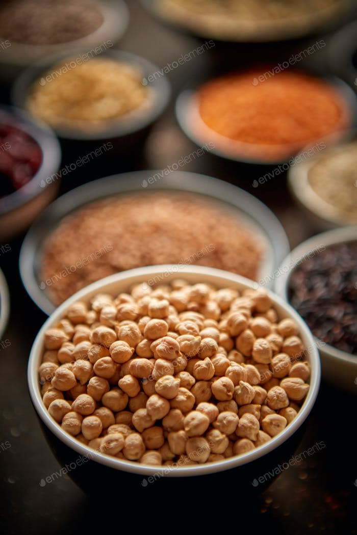 Raw peas seeds in ceramic bowl. Selective focus
