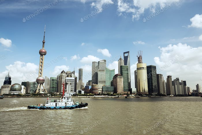 shanghai skyline and a tugboat