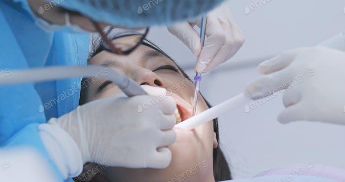 Dentist examines the patient teeth