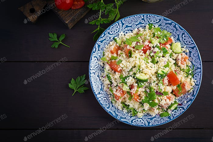 Traditional Lebanese Salad Tabbouleh. Couscous with parsley, tomato, cucumber, lemon