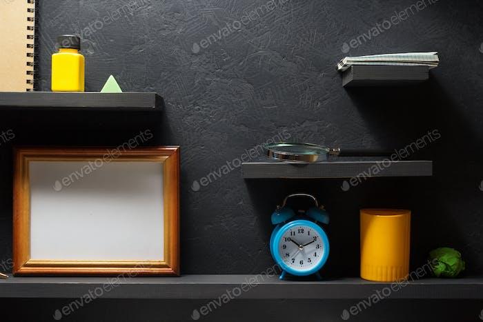school supplies at wooden black shelf