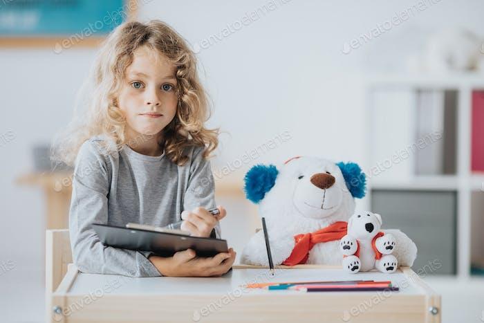 Sitting with a teddy bear