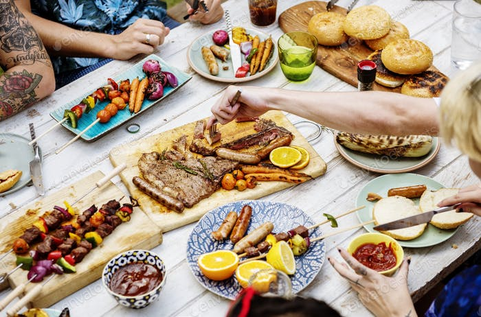 Closeup of homemade grilled food on wooden table summer party