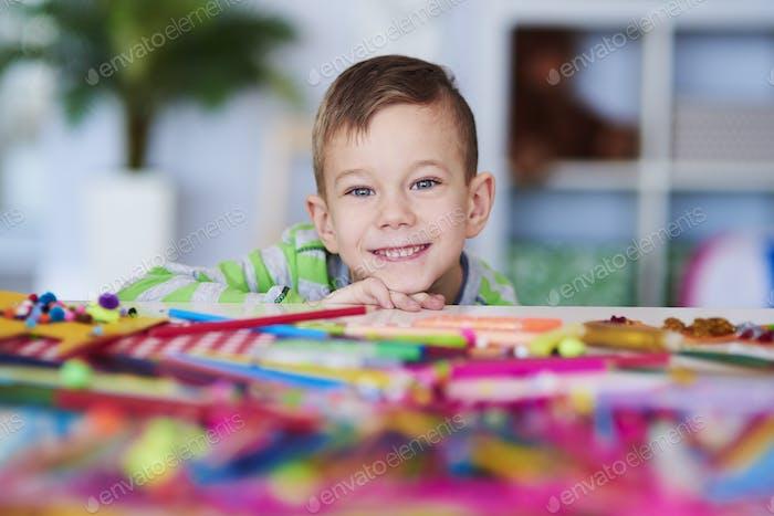Portrait of happy preschooler with big smile on his face