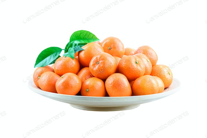 Heap of mandarin in bamboo plate isolated