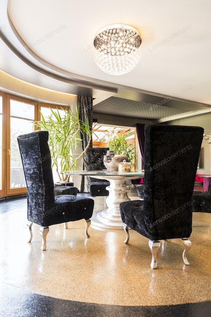 Extravagant interior with velvet chairs