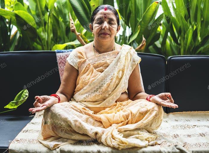 A meditating Indian woman
