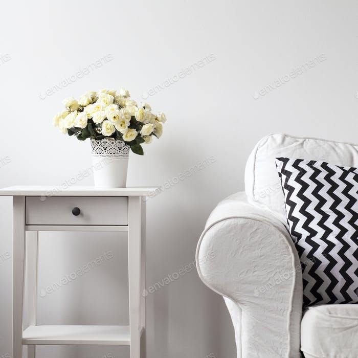 Wooden etagere and white sofa