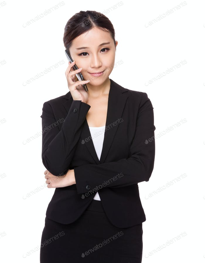Asian Businesswoman talk to phone