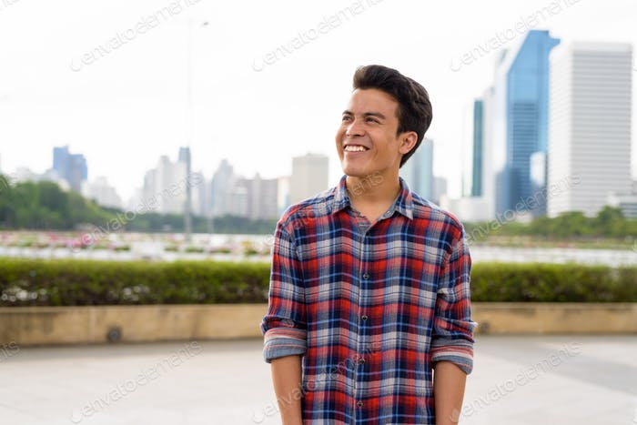 Young Asian man relaxing at the park
