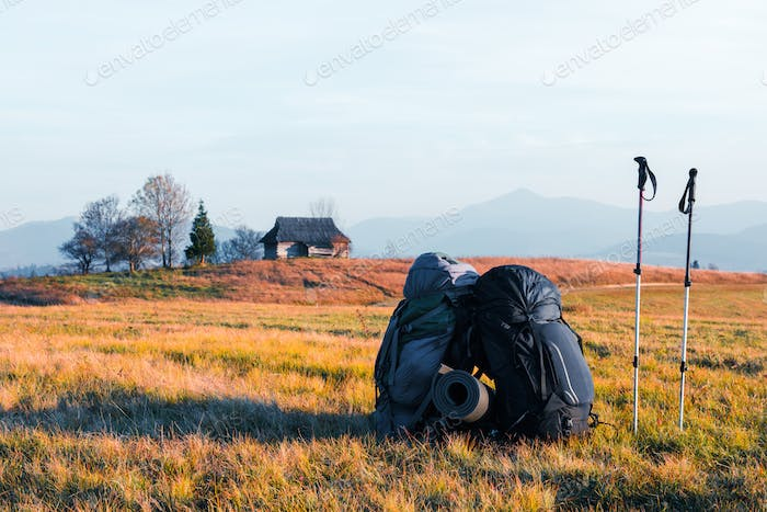 Two backpacks in mountains valley