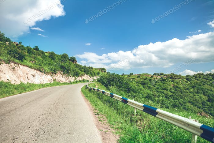 View on road and blue sky with clouds