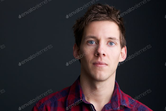 Man with blue eyes on gray background