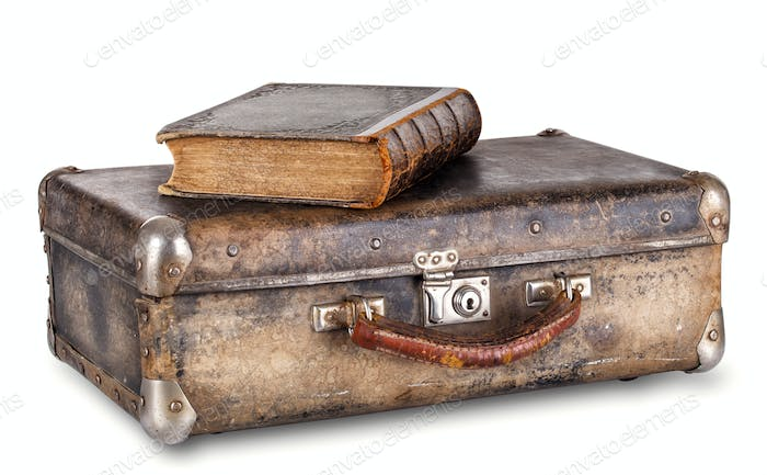 Old book on a suitcase