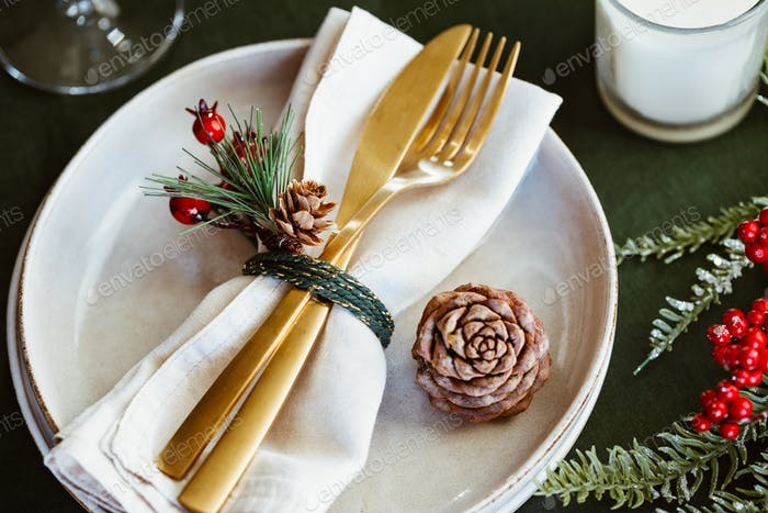Festive table setting with winter decor. The concept of Thanksgiving or Christmas