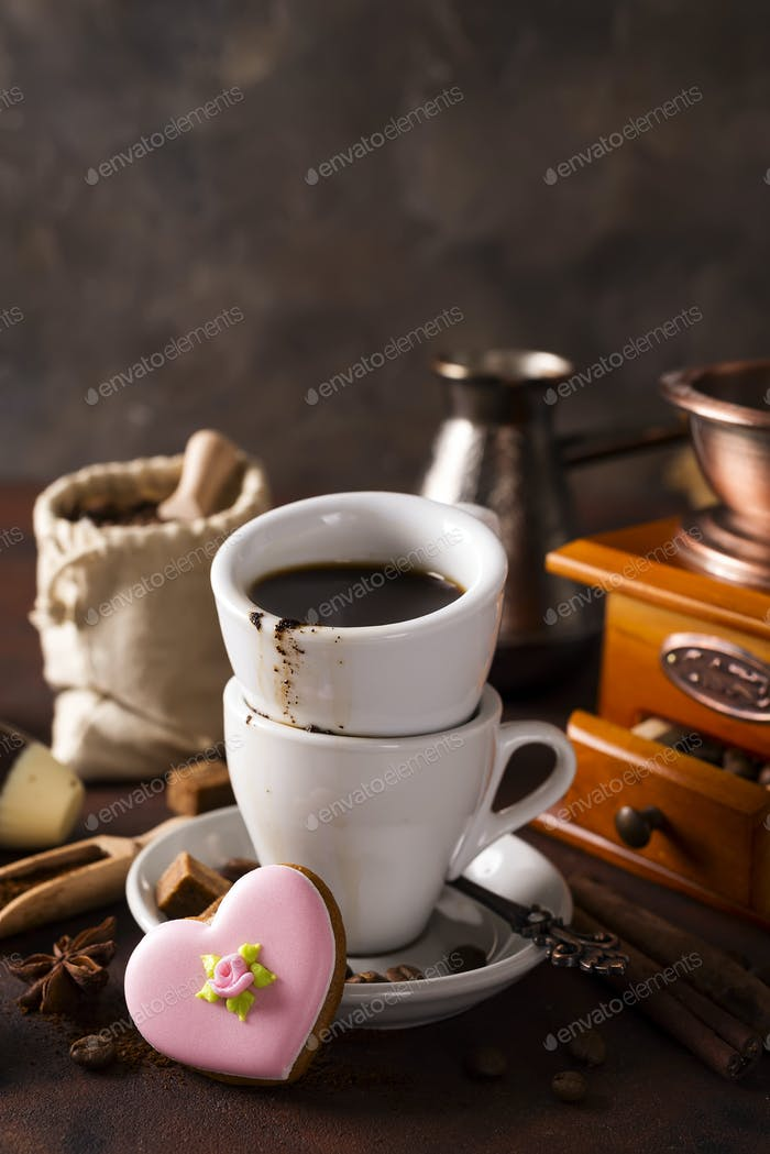 Coffee cup and beans on a dark background.