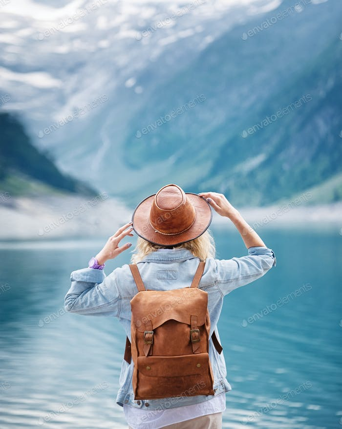 Travel image. Traveler look on the mountain lake. Travel and active life concept.