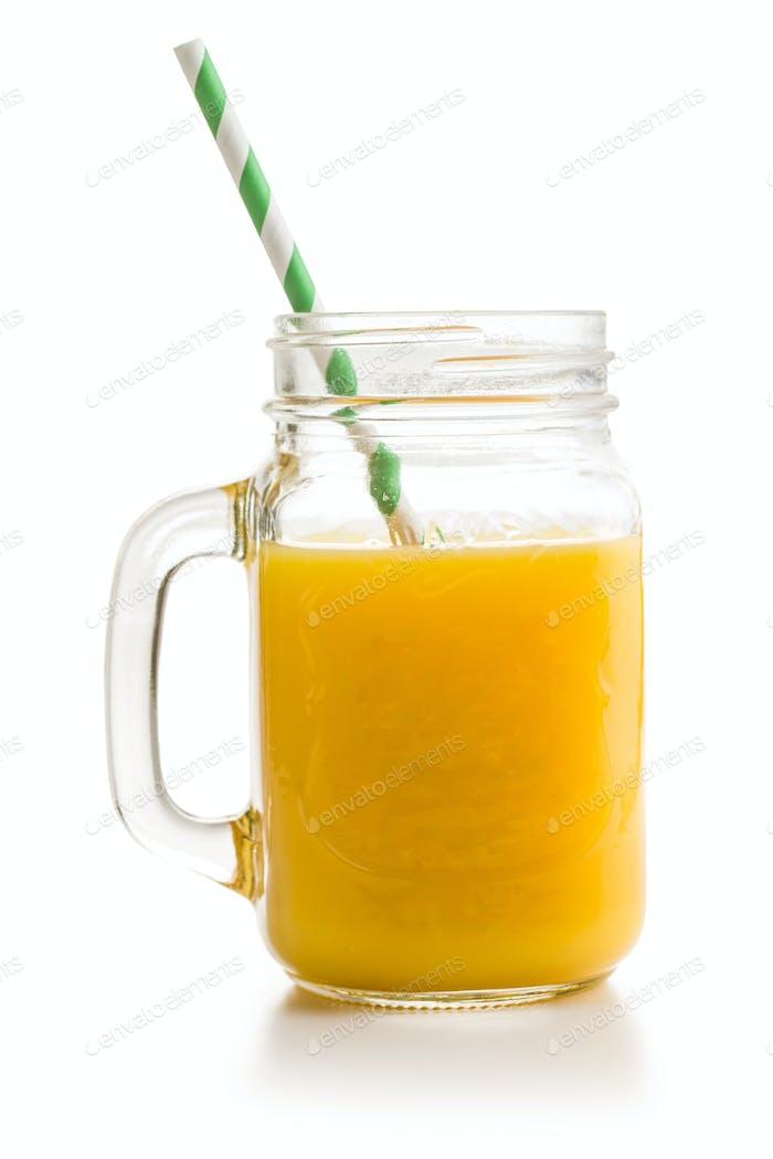 Pitcher of orange juice. Juice in glass.