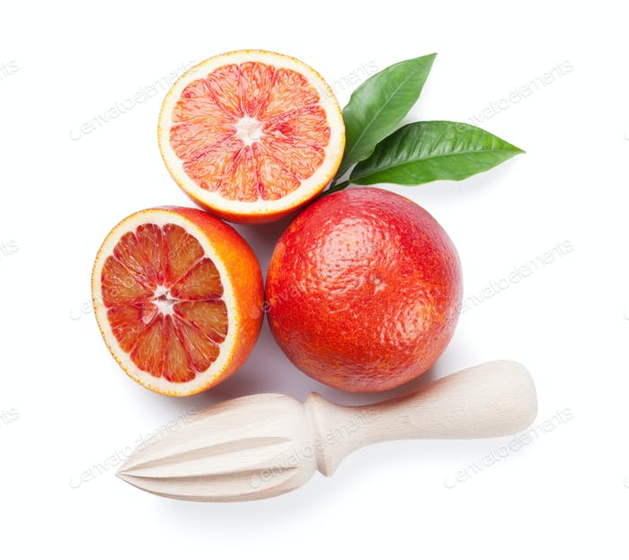 Fresh ripe red oranges and juicer