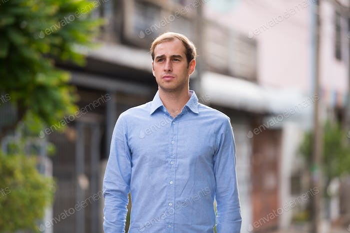 Young businessman in the streets outdoors