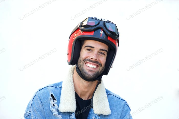 Close up smiling motorcyclist wearing helmet and jean jacket