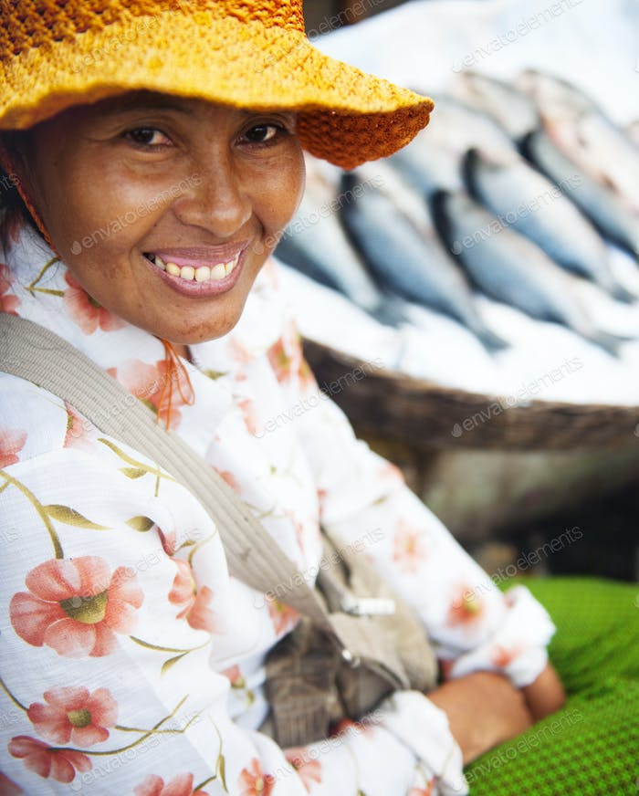 Indigenous Cambodian Woman Selling Fish In A Market