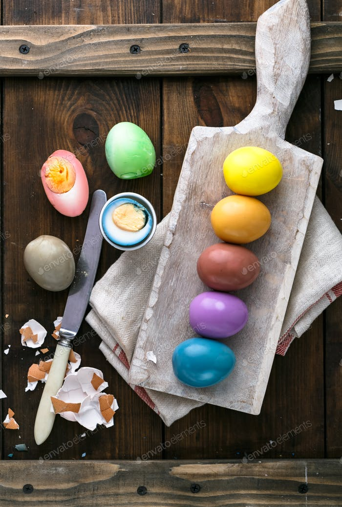 Peeled Colorful Easter eggs background, top view