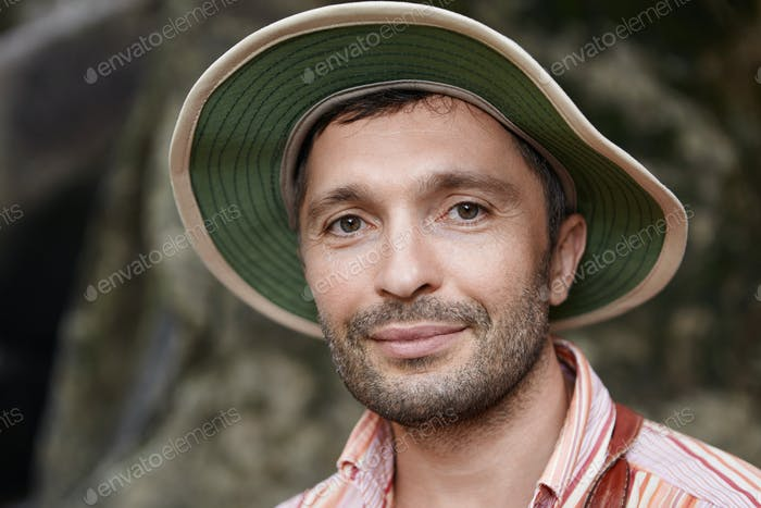 Ecology and environmental conservation concept. Joyful middle aged biologist wearing panama looking