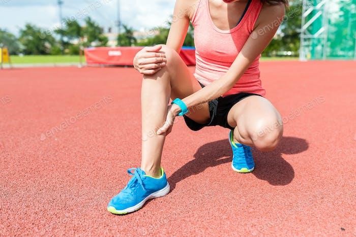 Sport woman getting hurt on legs