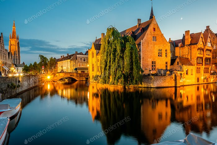 Bruges (Brugge) cityscape with water canal at night