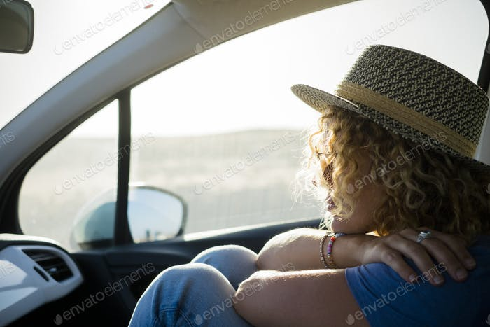 Portrait of woman traveling inside a car