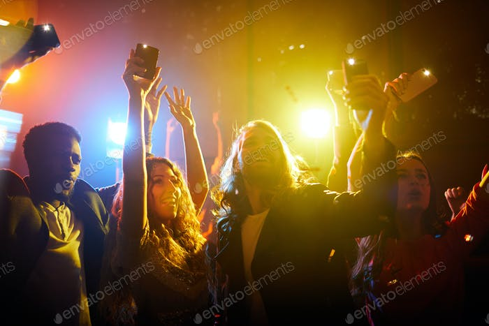 Jolly people screaming at musical concert