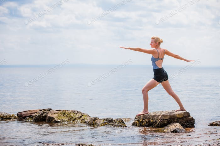 Young Woman doing Warrior Yoga Position