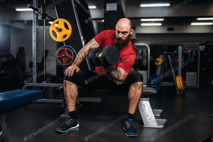 Strong athlete with dumbbell in action, workout