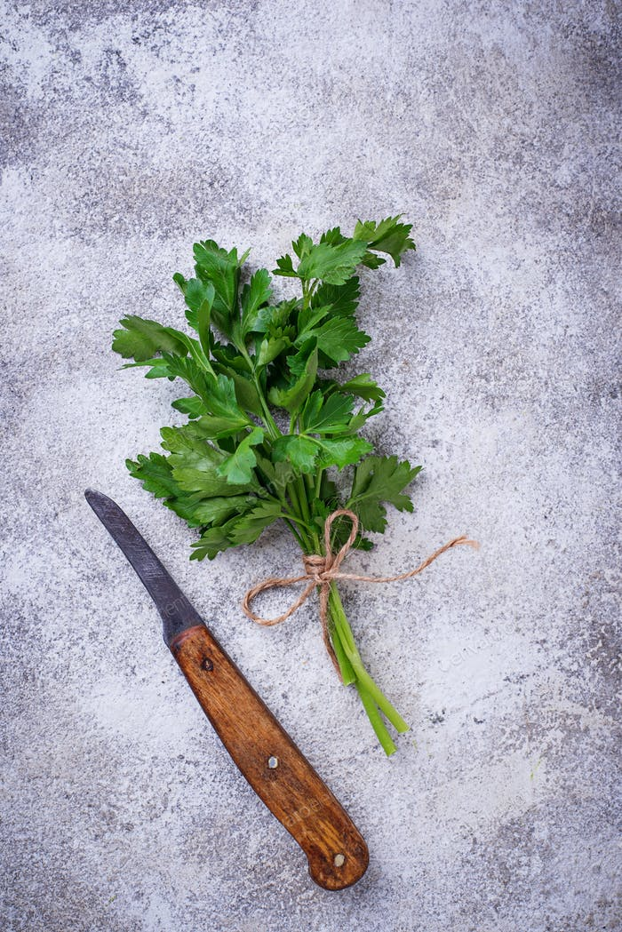 Bunch of fresh parsley and knife