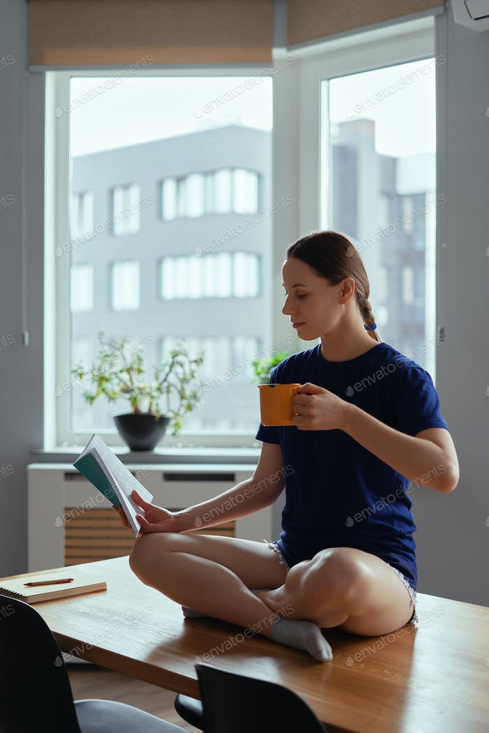 Reading in yoga pose on table stay home activity