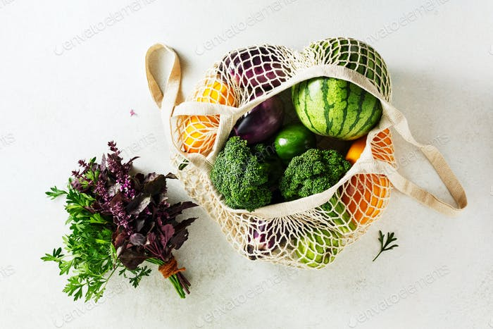 Reusable shopping bags with vegetables