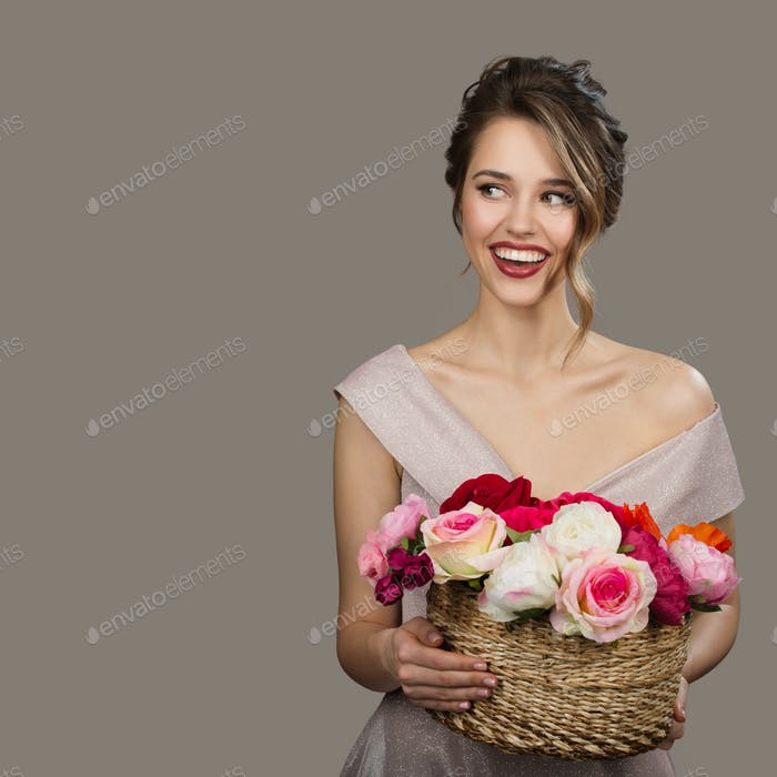 Portrait Of Pretty Smiling Woman Holding Flowers.