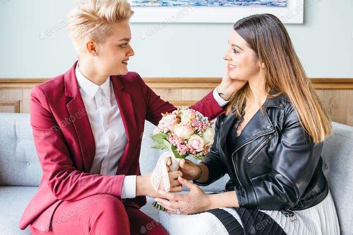 Beautiful girlfriends posing with flowers