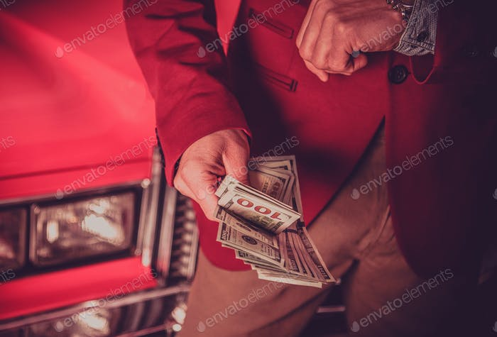 Car Salesman with Cash Dollars in His Hands