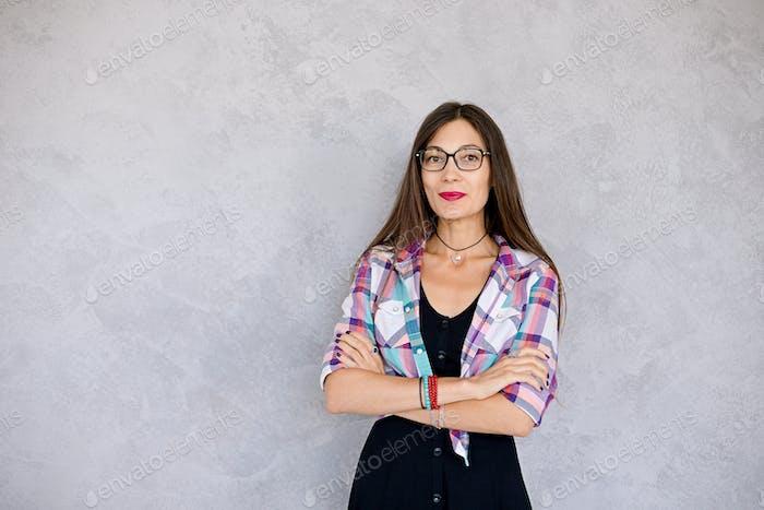 Smiling woman wearing glasses studio shot