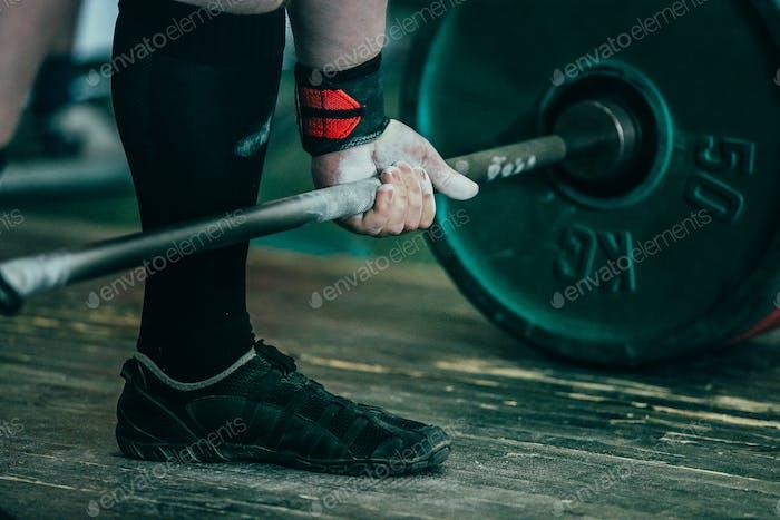 Closeup of hands of powerlifter