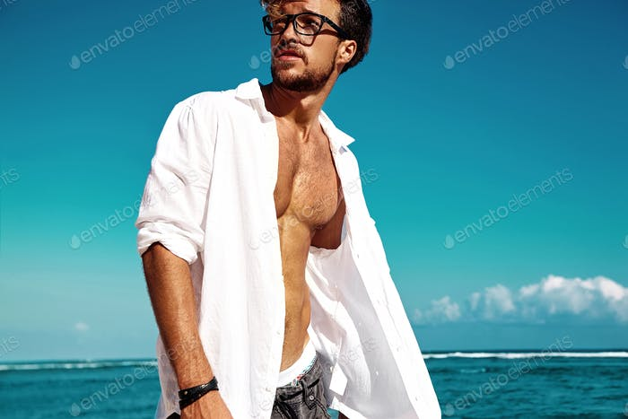 Portrait of handsome man posing at the beach
