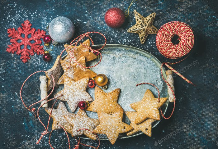 Christmas star shaped gingerbread cookies, decorative snowflakes, balls and toys