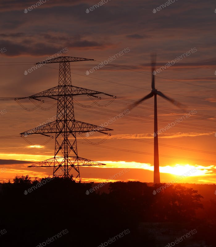 wind energy harvesting wind mills at sunrise